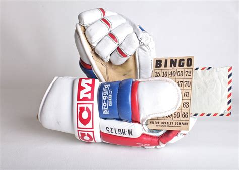 Red White and blue CCM hockey gloves